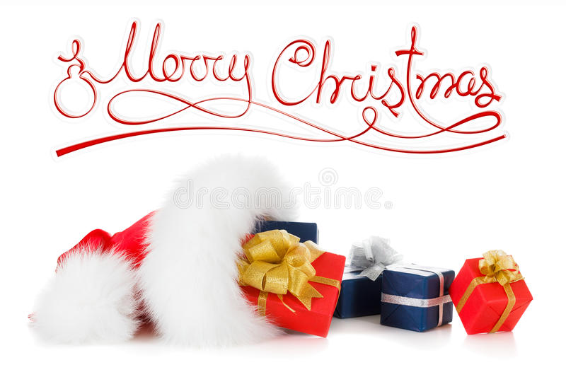 O Feliz Natal text, chapéu vermelho de Santa com presente fotos de stock royalty free