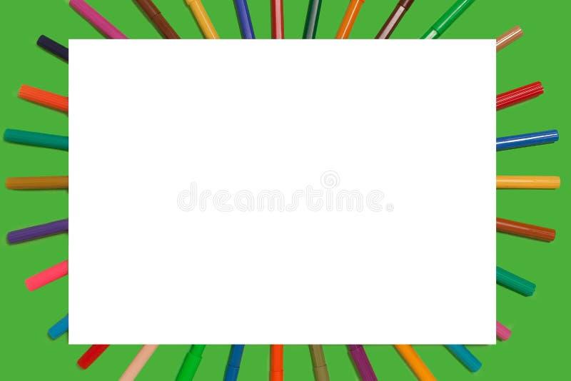 O feltro encerra o encontro sob uma folha do Livro Branco imagem de stock
