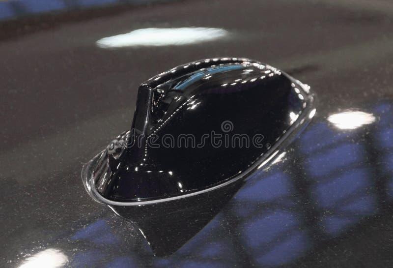 O fim acima da antena preta do telhado do carro imagem de stock royalty free