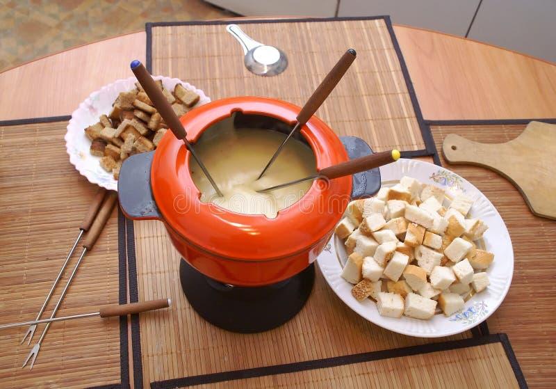 O fondue fotografia de stock