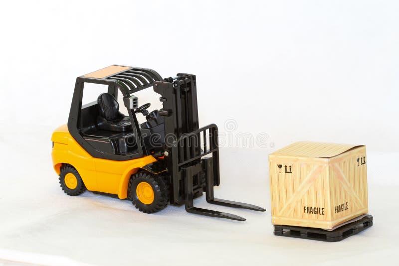 O Forklift descarrega imagens de stock