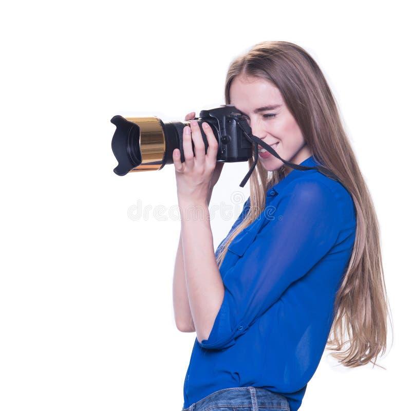 O fotógrafo da mulher toma as imagens, isoladas fotografia de stock royalty free