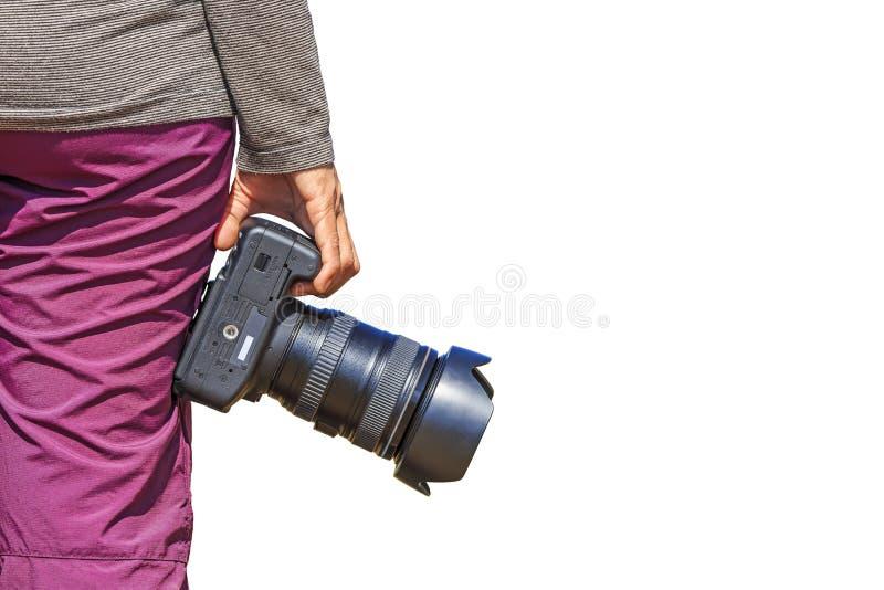 O fotógrafo guarda sua câmera de DSLR fotos de stock royalty free