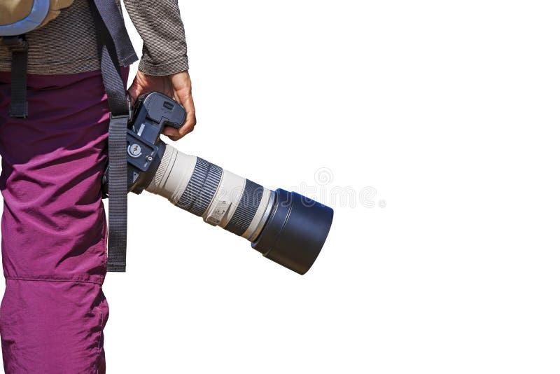 O fotógrafo guarda sua câmera de DSLR fotos de stock