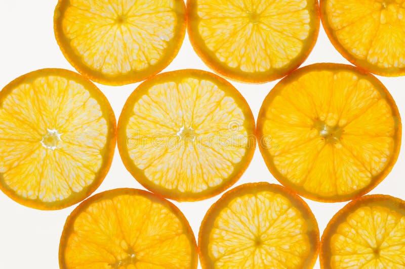 O fruto fresco corta o fundo sem emenda abstrato do teste padrão, laranjas fotografia de stock royalty free
