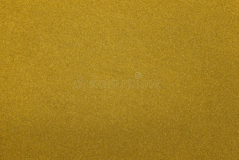 O fundo é uma tela tecida ouro fotos de stock royalty free