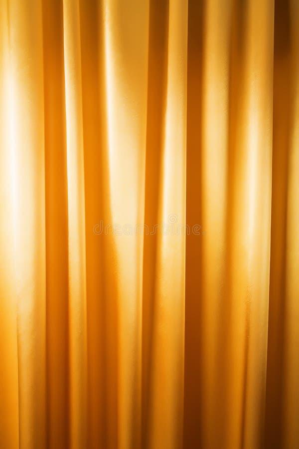 O fundo abstrato, cortina, drapeja a tela do ouro. fotografia de stock royalty free
