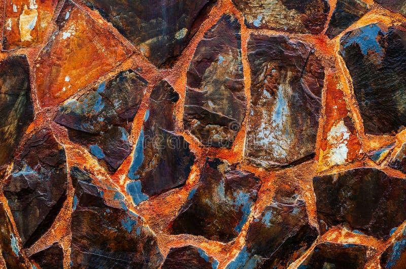 O fundo abstrato, testes padrões velhos das telhas do revestimento da pedra da parede handcraft a parede projetada construção da  foto de stock royalty free
