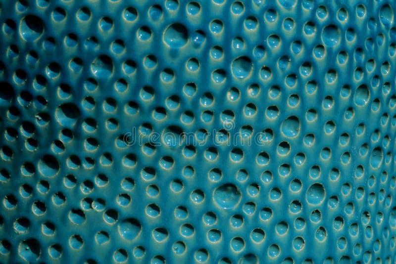 O fundo azul da superfície da textura da bolha faz da água cerâmica do formulário da bolha do conceito imagem de stock royalty free