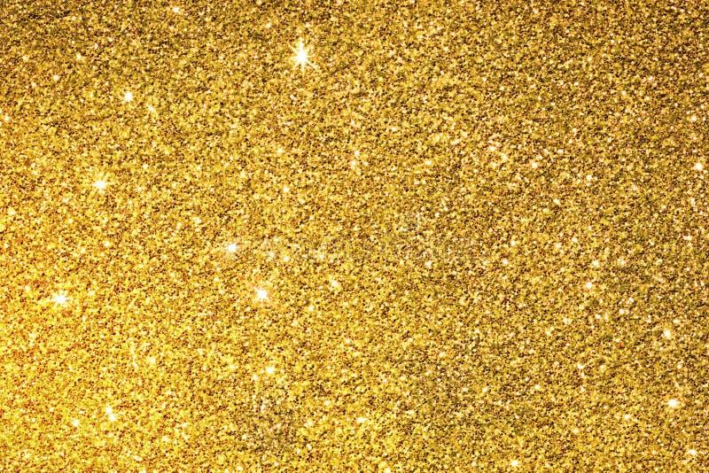 O fundo da superfície da textura do brilho do ouro imagens de stock