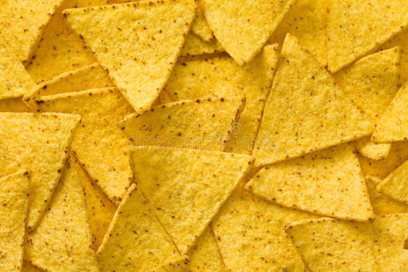 O fundo das microplaquetas dos nachos imagem de stock