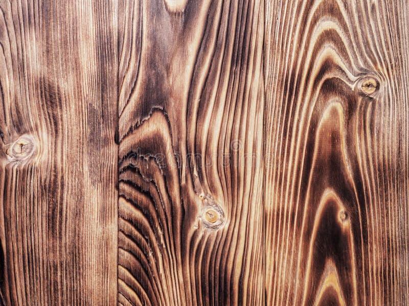 O fundo de madeira do pinho de madeira queimou a textura do sumário da escova de pintura imagens de stock royalty free