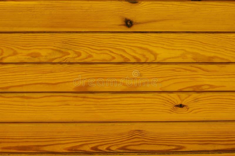 O fundo de madeira vazio vazio amarelo, superfície escura pintada da tabela, textura de madeira colorida embarca com espaço da có fotografia de stock
