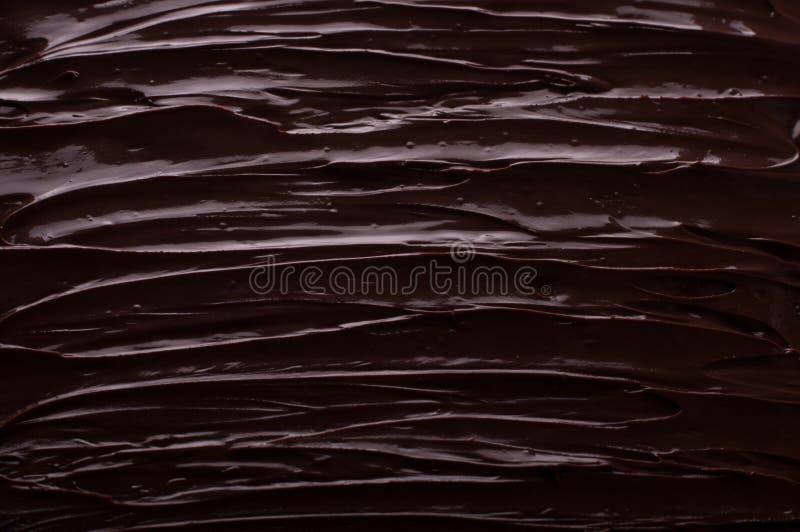 O fundo do chocolate acena cozinhando o conceito - chocolate derretido a fotografia de stock