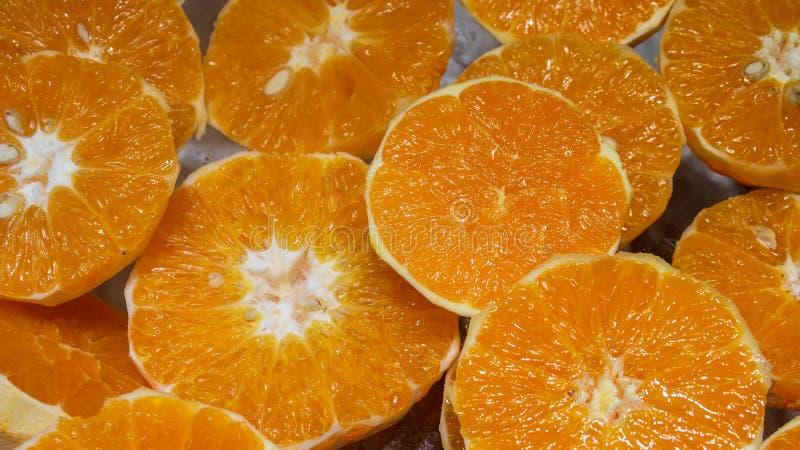 O fundo do fruto alaranjado fresco fotografia de stock