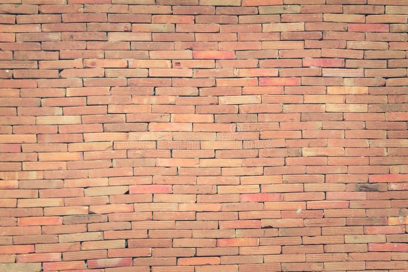 O fundo do grunge da textura da parede de tijolo vermelho com cantos vignetted, pode usar-se ao design de interiores imagem de stock