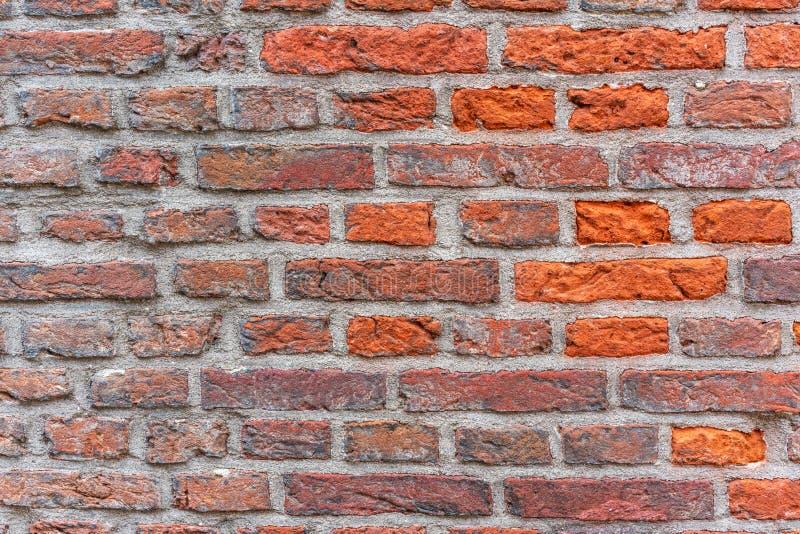 O fundo do grunge da textura da parede de tijolo vermelho, pode usar-se para o design de interiores foto de stock