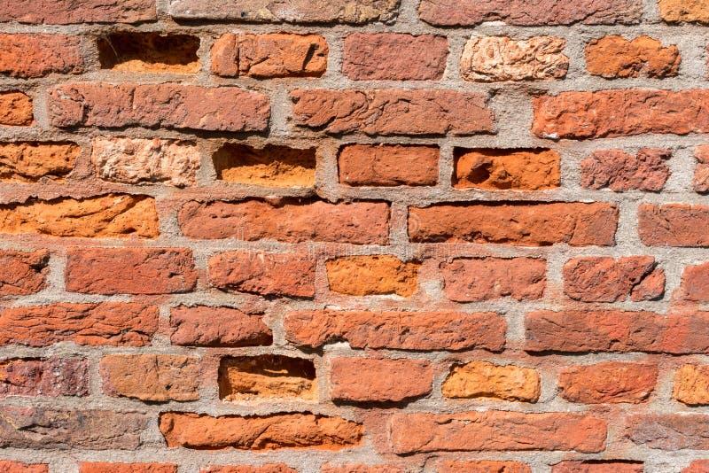 O fundo do grunge da textura da parede de tijolo vermelho, pode usar-se para o design de interiores fotos de stock royalty free