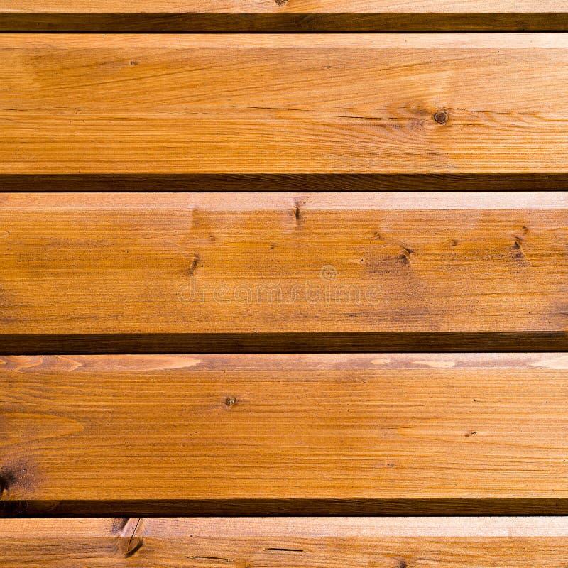 O fundo do pinho de madeira novo de planeamento lubrificou a madeira fotografia de stock royalty free