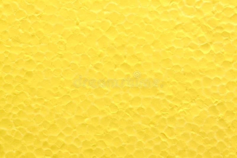 O fundo do styrofoam amarelo brilhante fotografia de stock
