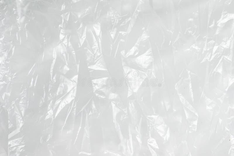 O fundo do sumário amarrotou o saco de lixo branco da textura do filme plástico imagens de stock