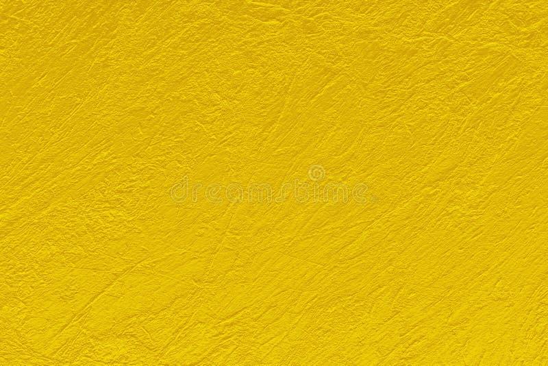 O fundo do sumário do teste padrão da textura da cor do ouro pode ser uso como a capa do folheto da poupança de tela do papel de  fotos de stock royalty free