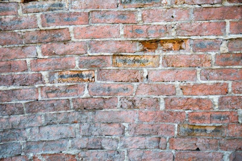 O fundo do tijolo velho imagens de stock
