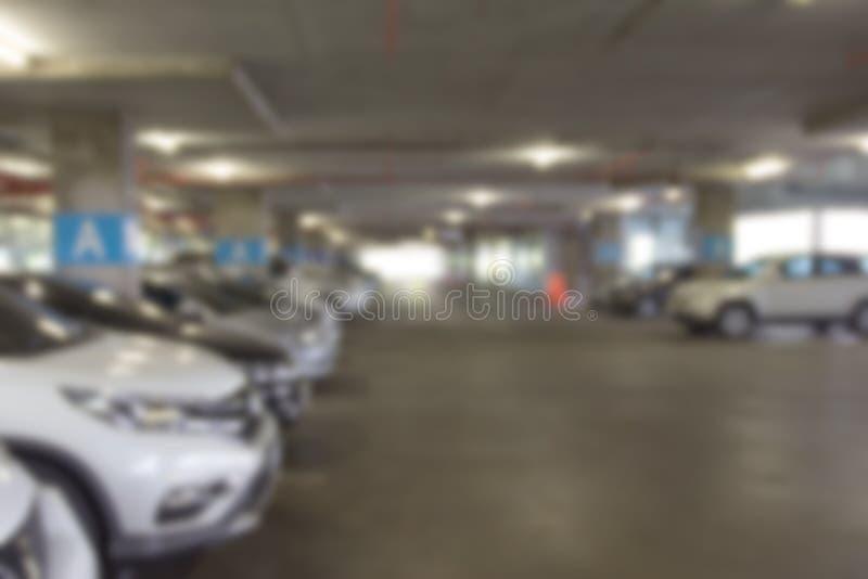 O fundo interior do borrão do parque de estacionamento do carro, sumário borrou imagens de stock