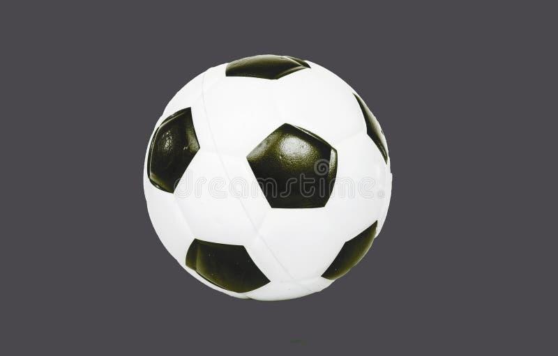 O futebol da bola de futebol no cinza isolou o fundo cortado entalhe Fácil de usar fotografia de stock royalty free