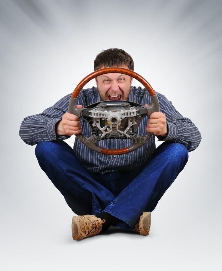 O gajo irreal com uma roda nas mãos imagem de stock