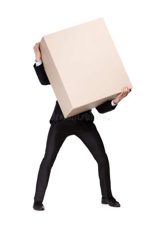 O gerente carrega um pacote enorme foto de stock