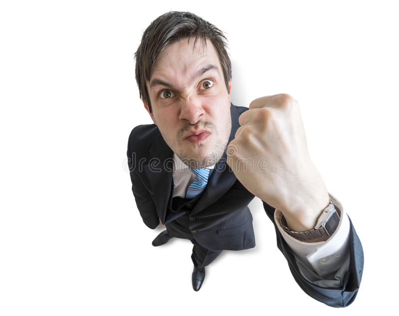 O gerente irritado novo está ameaçando com o punho isolado no fundo branco Vista da parte superior foto de stock