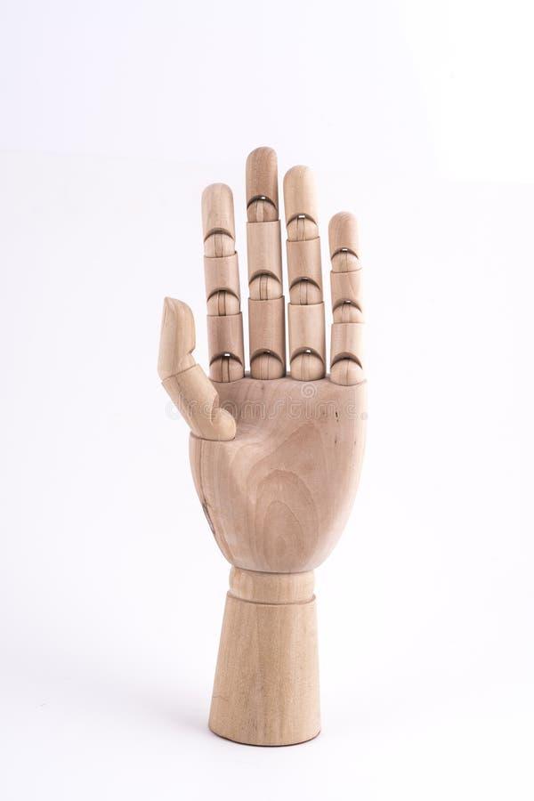 O gesto da parada com uma mão de madeira articulada foto de stock