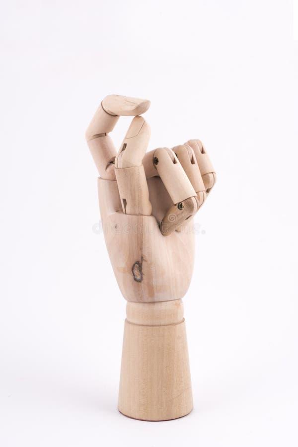 O gesto de dois dedos feitos junto com uma mão de madeira articulada imagens de stock royalty free