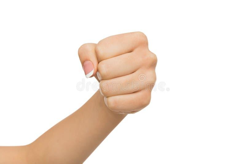 O gesto de mão, mulher apertou o punho, apronta-se para perfurar imagens de stock royalty free
