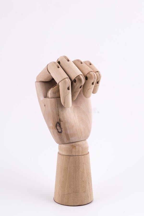 O gesto de um punho com uma mão de madeira articulada fotografia de stock royalty free