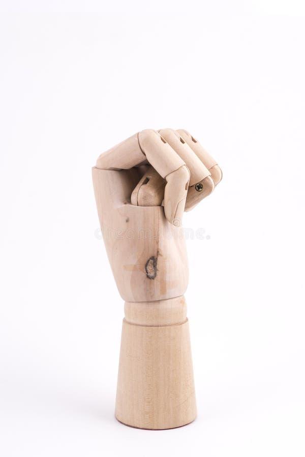 O gesto de um punho com uma mão de madeira articulada fotos de stock royalty free