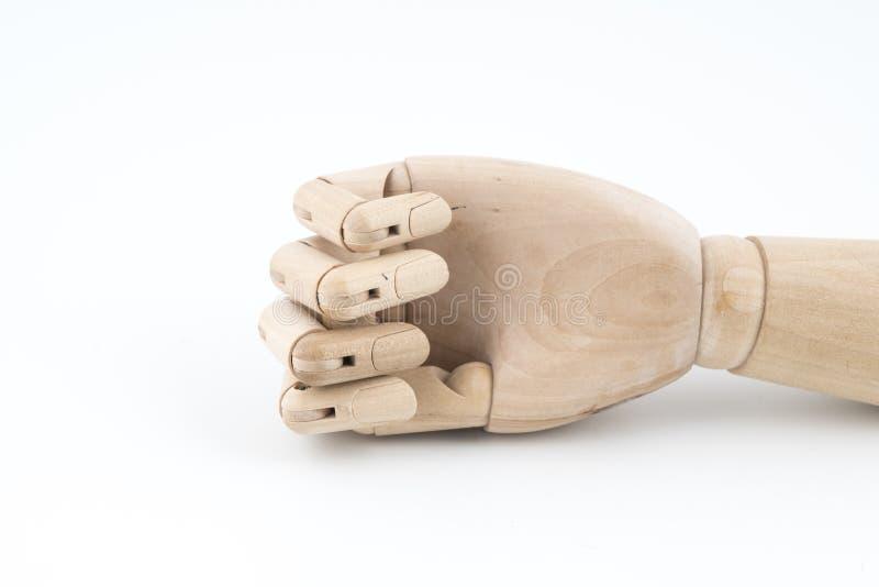 O gesto de uma mão de madeira articulada que descansa na tabela fotos de stock royalty free