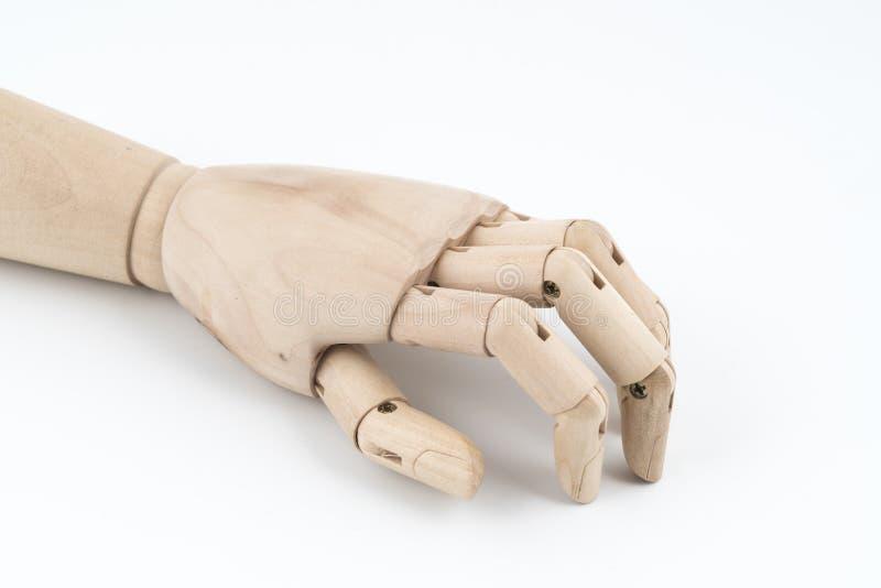 O gesto de uma mão de madeira articulada que descansa na tabela imagens de stock royalty free