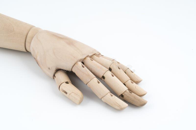 O gesto de uma mão de madeira articulada que descansa na tabela foto de stock