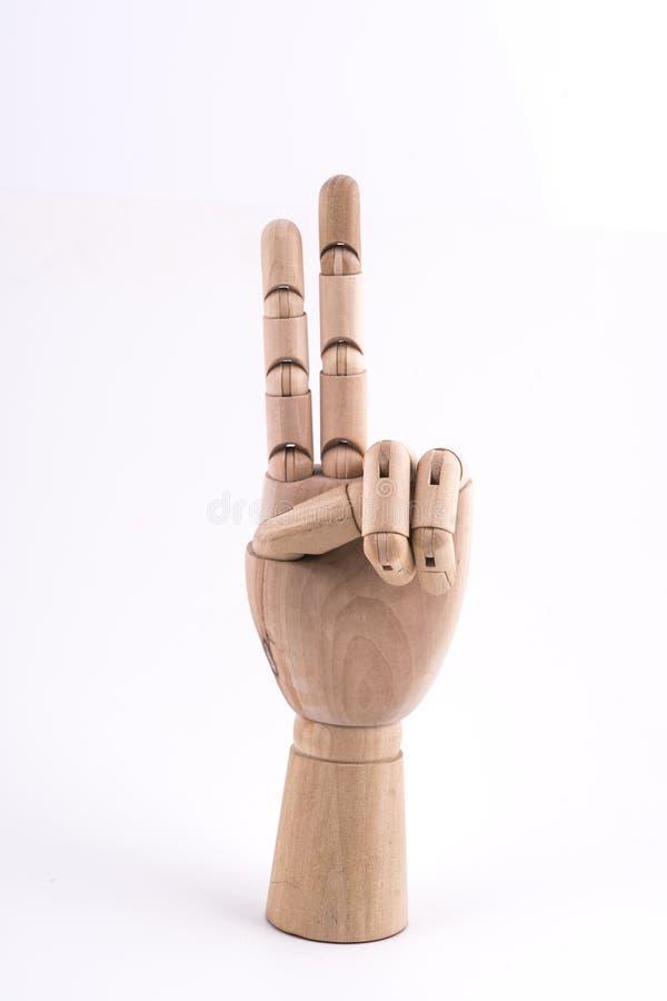 O gesto do número dois fez com uma mão de madeira articulada fotografia de stock