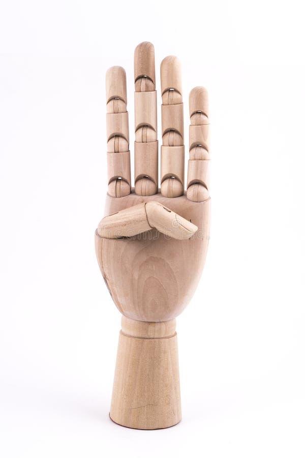 O gesto do número quatro fez com uma mão de madeira articulada foto de stock royalty free