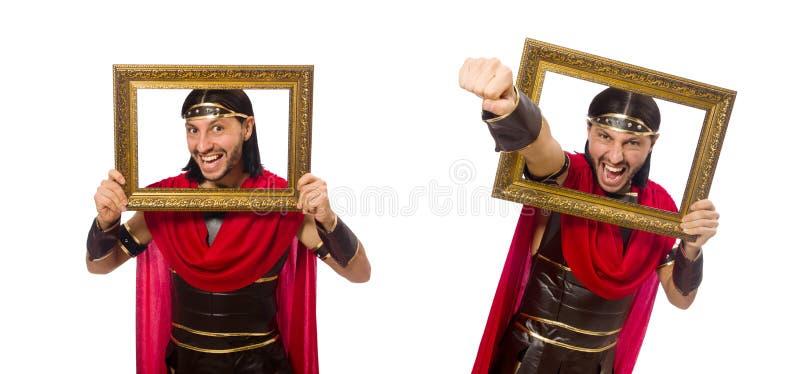 O gladiador que mantém a moldura para retrato isolada no branco imagens de stock