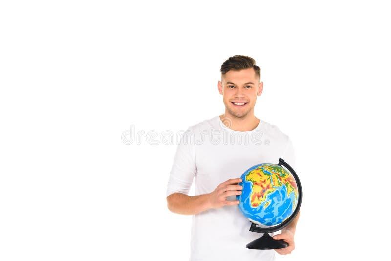 o globo de sorriso da terra arrendada do homem novo isolou-se fotos de stock royalty free