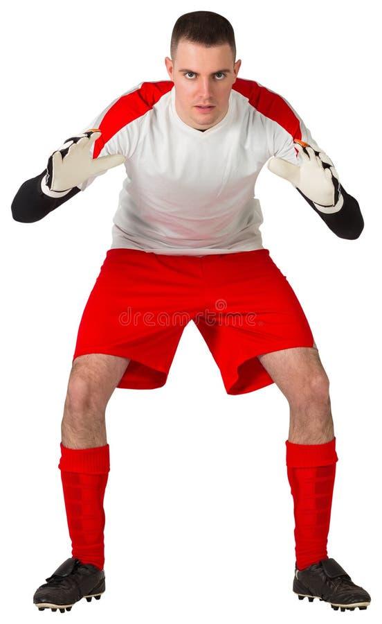 O goleiros em vermelho e em branco apronta-se para travar foto de stock royalty free