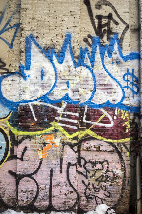O grafitti está escrevendo ou desenho na parede fotografia de stock royalty free