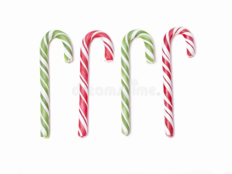 O grupo de doces do Natal quatro pode no fundo branco imagem de stock royalty free