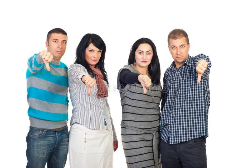 O grupo de pessoas triste dá os polegares para baixo imagem de stock