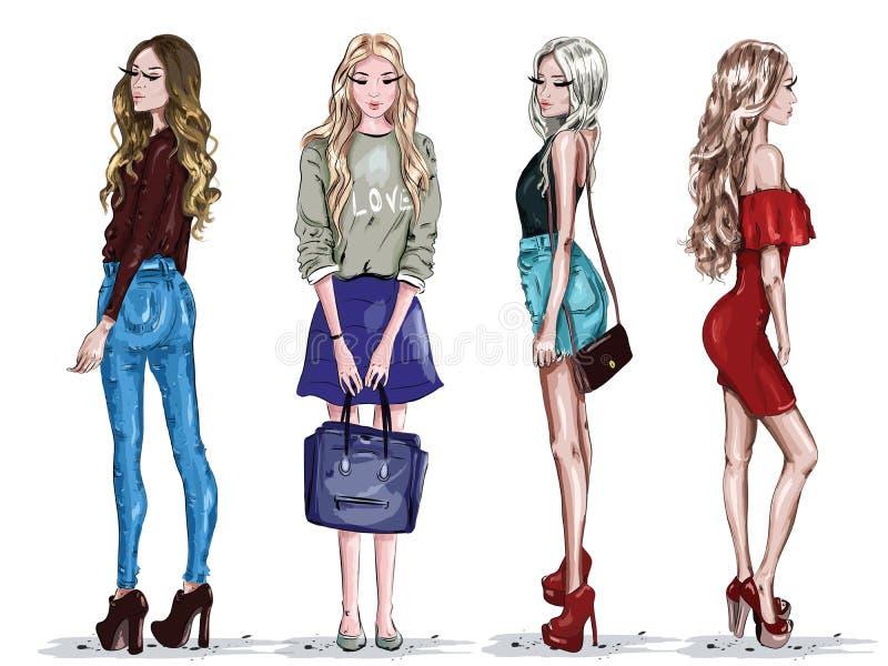 O grupo tirado mão com as jovens mulheres bonitas na forma veste-se Meninas à moda esboço ilustração stock