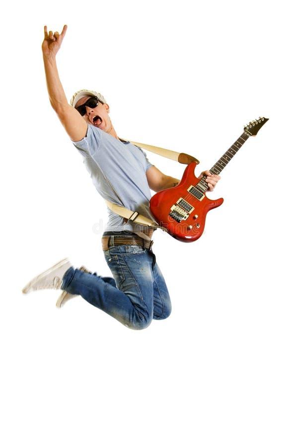 O guitarrista apaixonado salta isolado no branco fotografia de stock royalty free